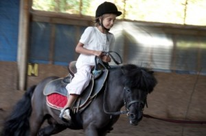 child riding with helmet